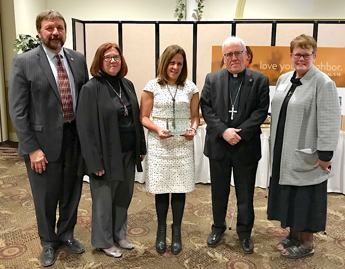 From left: Dennis C. Walczyk, Catholic Charities CEO; Kathleen Hall, Catholic Charities Niagara County district director; Hon. Diane Vitello, Niagara Falls City Court judge; Bishop Richard J. Malone; and Sister Mary McCarrick, Catholic Charities diocesan director.
