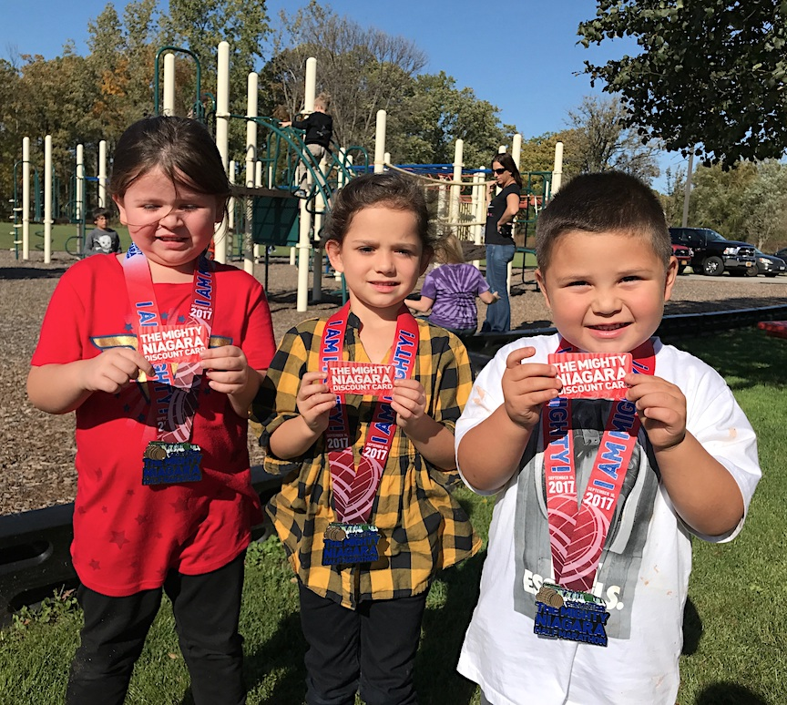 Top sellers: Tuscarora Indian School students Danyka, Aria and Elliot sold the most Mighty Niagara Discount Cards to raise money for their school and Niagara Hospice.