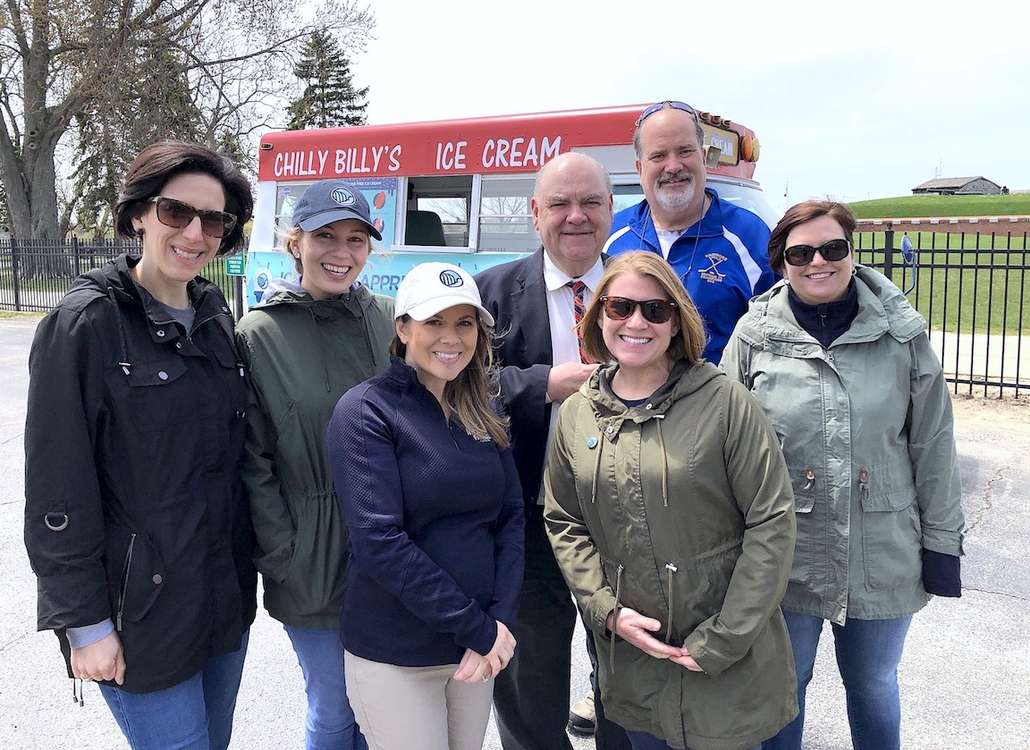 Pictured outside of Old Fort Niagara, Chilly Billy's owner Bill Pavone and Destination Niagara USA's Libby Woock, Krystina Andersen, Lana Perlman, Andrea Czopp and Reanna Darone greeted Old Fort Niagara's Bob Emerson (suited). A number of volunteers - some dressed in period outfits, plus guests at the Youngstown attraction - enjoyed a free ice cream on Thursday.