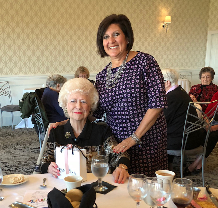Marion Baker, left, of Niagara Falls receives a gift from Niagara Falls Memorial Medical Center Volunteer Services Director Judy Villani. Baker was honored at this year's volunteer luncheon for volunteering 50 years in patient escort services at Memorial.