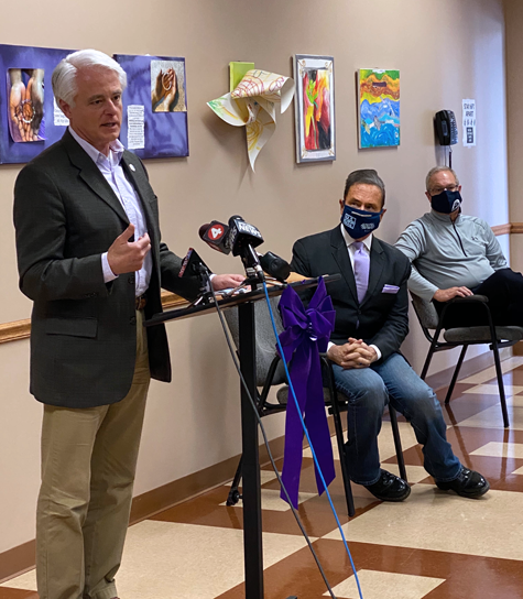 Niagara Falls Mayor Robert Restaino addresses the media as Congressman Brian Higgins and Homeless Alliance of WNY Executive Director Dale Zuchlewski listen.