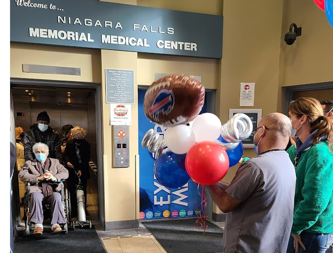 Nurses, doctors and other members of the Niagara Falls Memorial Medical Center team applaud COVID-19 patient and avid Buffalo Bills fan Richard Portale on Saturday as he is discharged from the hospital after a 60-day stay - just in time to watch Sunday's AFC Championship game from his home.