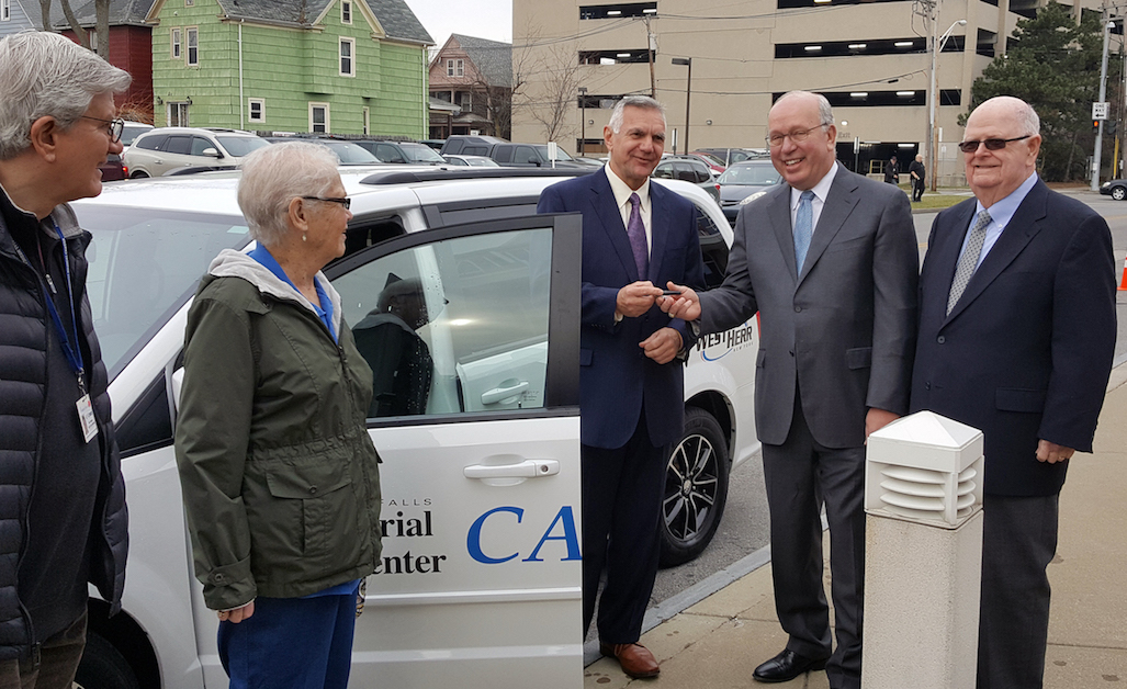 Memorial Medical Center President and CEO Joseph A. Ruffolo, center, is presented the keys to a 2017 Dodge Caravan CARExpress van by West Herr Automotive Group President and CEO Scott Bieler. Looking on, from left, are CARExpress volunteers Rick Berggren and Marge Neal and, at right, Cave of the Winds Corp. Chairman and longtime CARExpress supporter James V. Glynn.