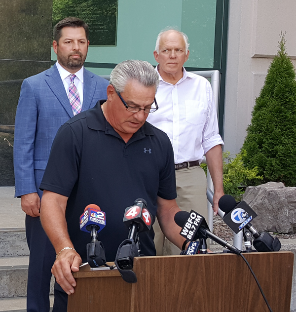 Niagara Falls Water Board Chairman Dan O'Callaghan address the media on Thursday as Water Board officials look on. (Photo by Terry Duffy)