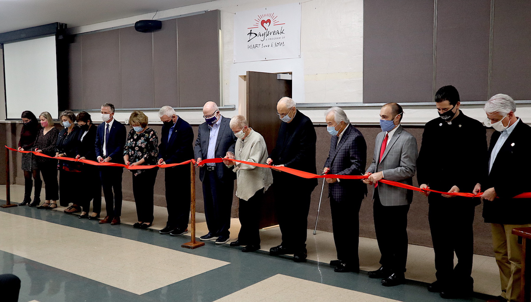 Local officials and administrators from Heart Love & Soul food pantry were on hand to commemorate the opening of the Sr. Beth Brosmer Center, home of the new Daybreak program, which will increase access to services and offer additional support for people experiencing homelessness.