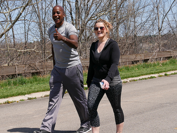 Two `Walk for Niagara` participants enjoy the sunshine, knowing their efforts will go toward helping others.