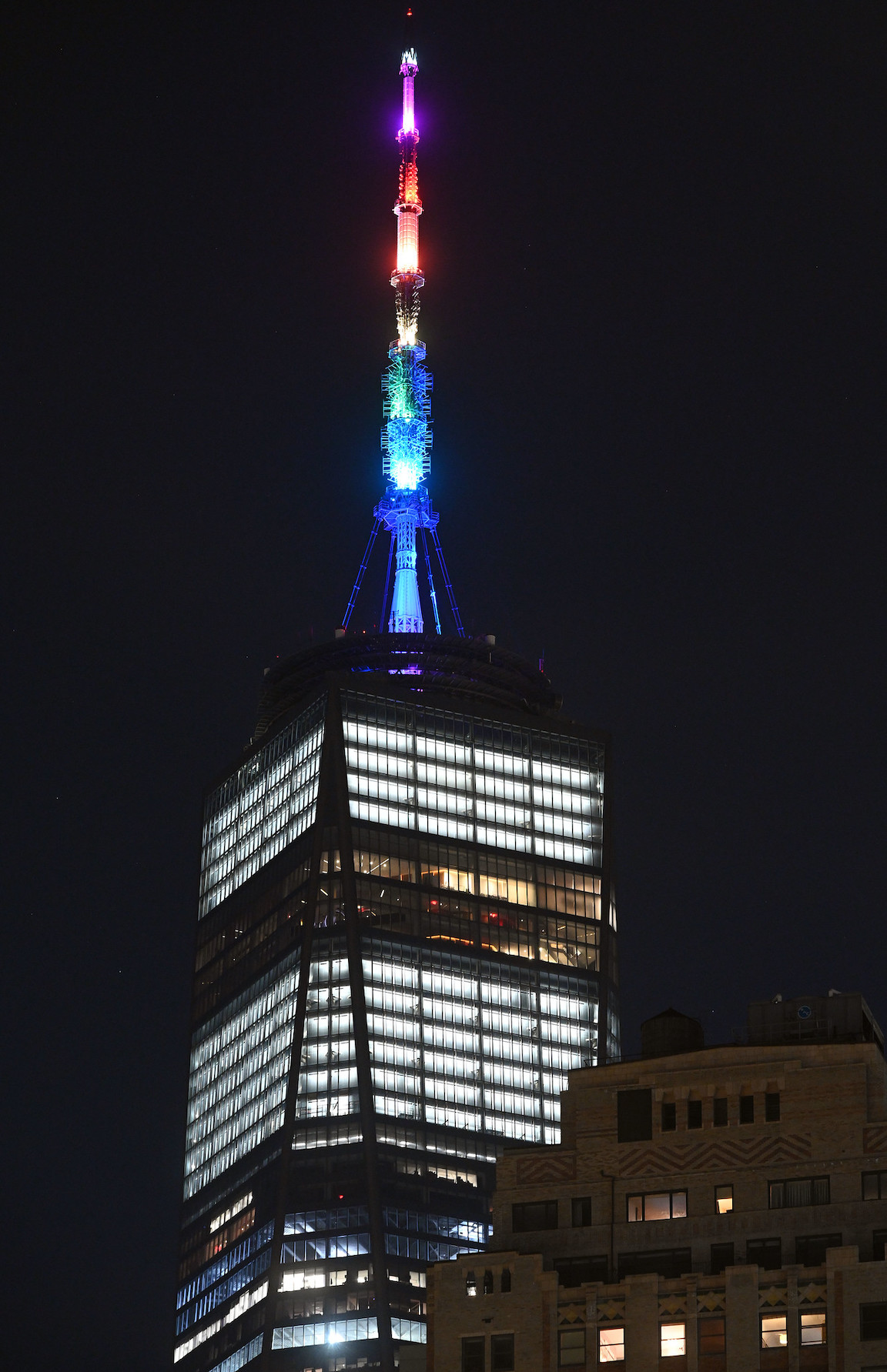 Gov. Andrew Cuomo announced landmarks across the state would be lit in honor of Pride Month and the LGBTQ community, including the spire of One World Trade Center (shown here), the Pershing Square Viaduct, the Kosciuszko Bridge, the Governor Mario M. Cuomo Bridge, the Mid-Hudson Bridge, the marque at the front of Whiteface Lake Placid Olympic Center, the SUNY Central Administration Building, the State Education Building, the Alfred E. Smith Building, Niagara Falls and the State Fair Exposition Center and LED boards featured at the State Fair main gate. The landmarks were illuminated in the colors of the Pride flag in celebration of Pride in New York and the 50th anniversary of the first Pride march in New York City. (Photo by Kevin P. Coughlin/Office of Gov. Andrew M. Cuomo)