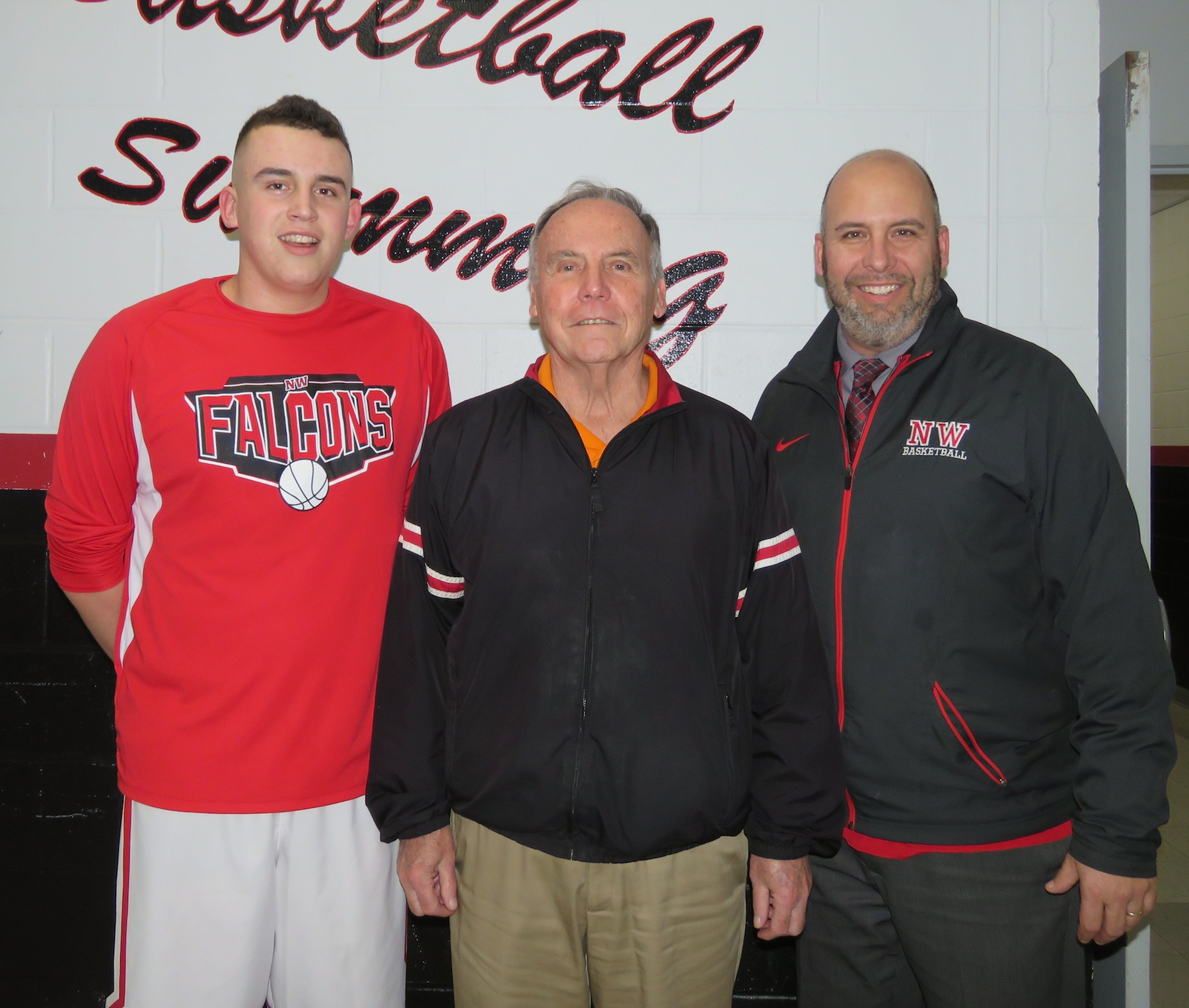 `We're the Miller:` From left, Cam, Don and Steve Miller pose for a photo before the Niagara-Wheatfield boys basketball team's contest versus Niagara Falls. (Photo by David Yarger)