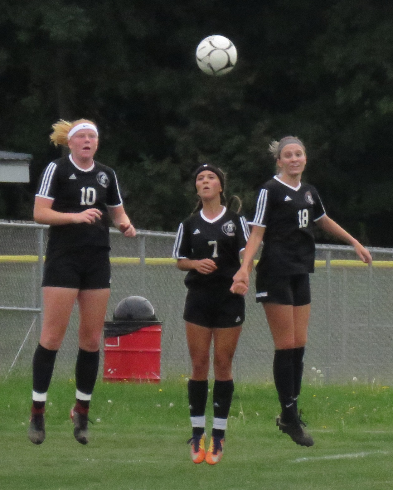 The trio of (from left) Erin Weir, Paige DiCarlo and Samantha Maghrak defend a free kick during a game versus Lewiston-Porter this season. (Photos by David Yarger)