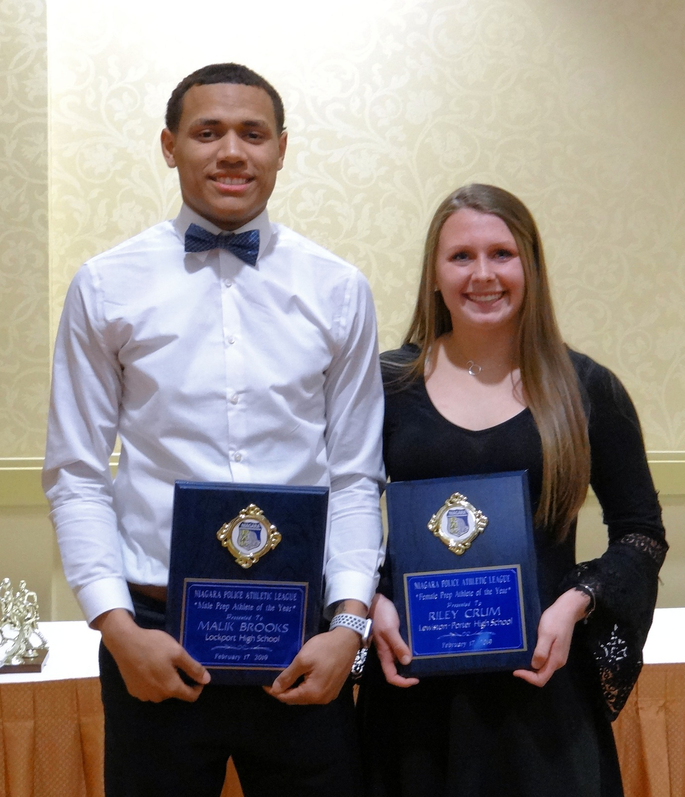 Pictured, from left, Malik Brooks of Lockport and Riley Crum of Lewiston-Porter pose as the 2018-19 Niagara PAL Prep Athletes of the Year. (Photos by Lorna Peltier)