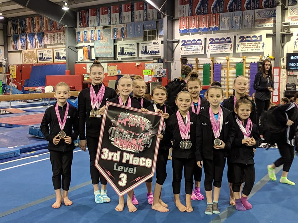 Local gymnasts from the Level 3 Gleason's School of Gymnastics team pose following participation in the Nickel City Classic in Orchard Park. (Submitted photo)