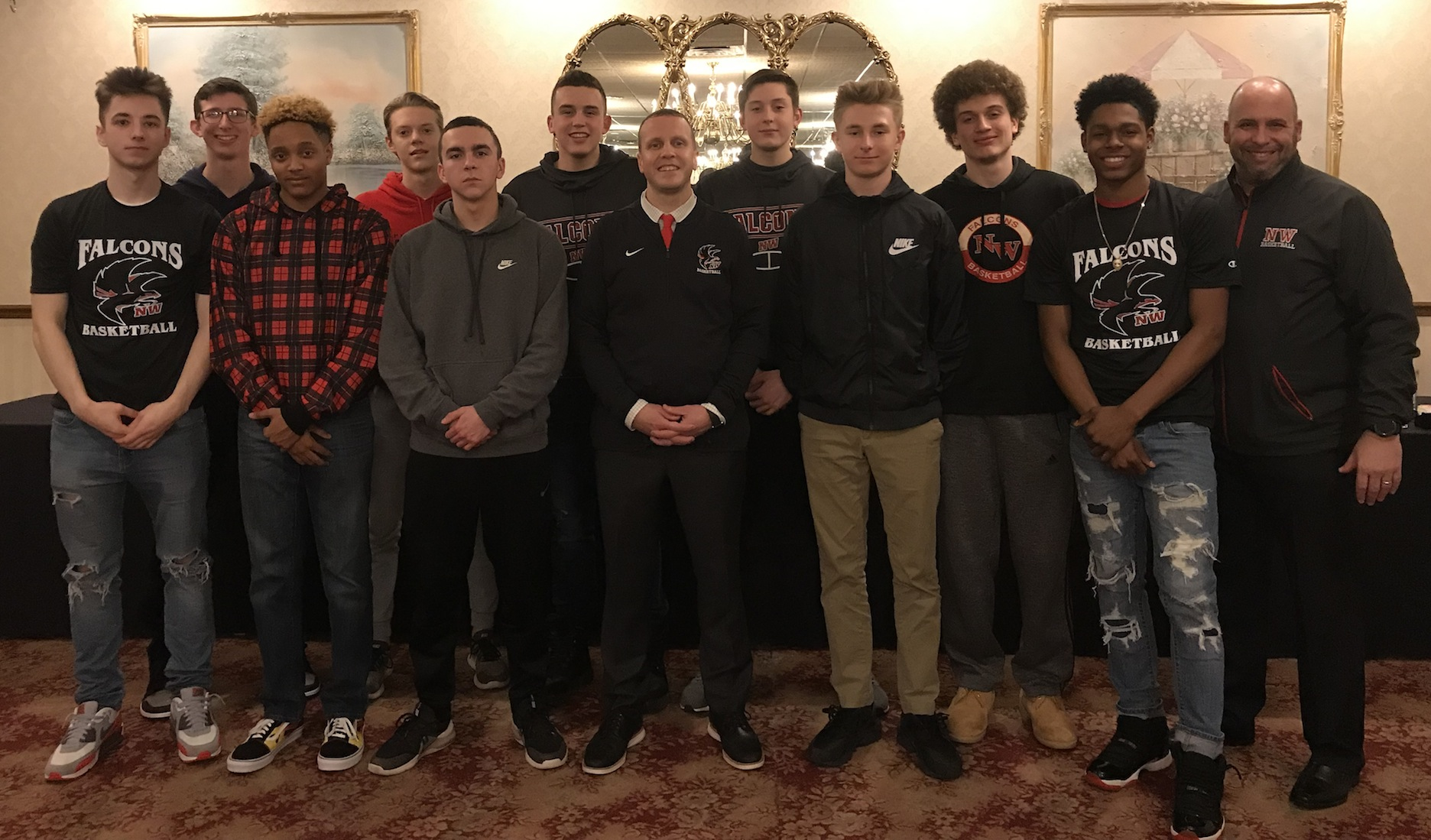 The Niagara-Wheatfield boys basketball team poses following its end-of-the-year banquet at Pane's restaurant. From left, back row, Jay Smith, Ryan Mellerski, Cam Miller, Joe Woroniecki, Zach Stanley and coach Steve Miller. From left, front row, Roman Wright, TJ Robinson, Ben Salomon, head coach Erik O'Bryan, Andy DeVantier and Raejaun Smith. (Photo by David Yarger)