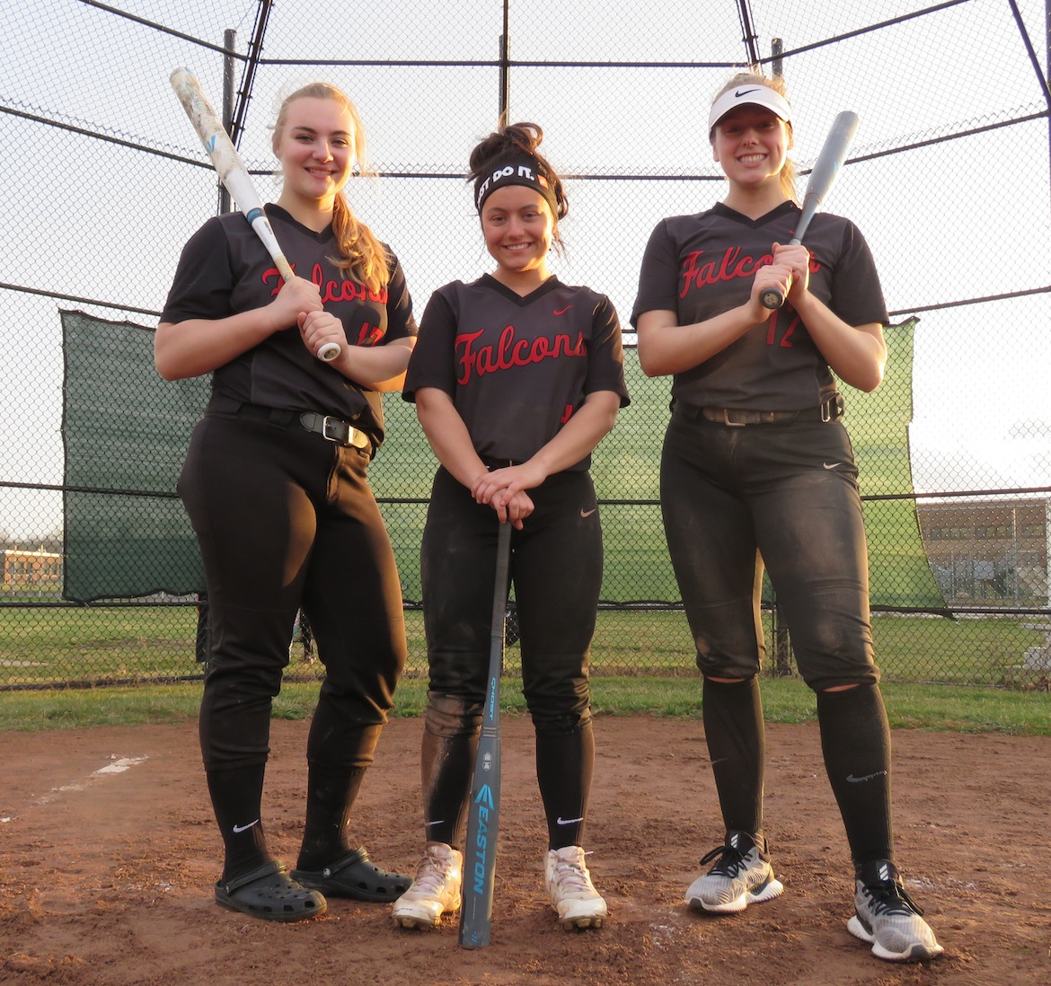 From left, Mackenzie Quider, Maddie Evarts and Mackenzie Franks pose for a photo following the team's 5-4 win over Lewiston-Porter. The trio of captains have a combined 16 years of varsity experience. (Photo by David Yarger)