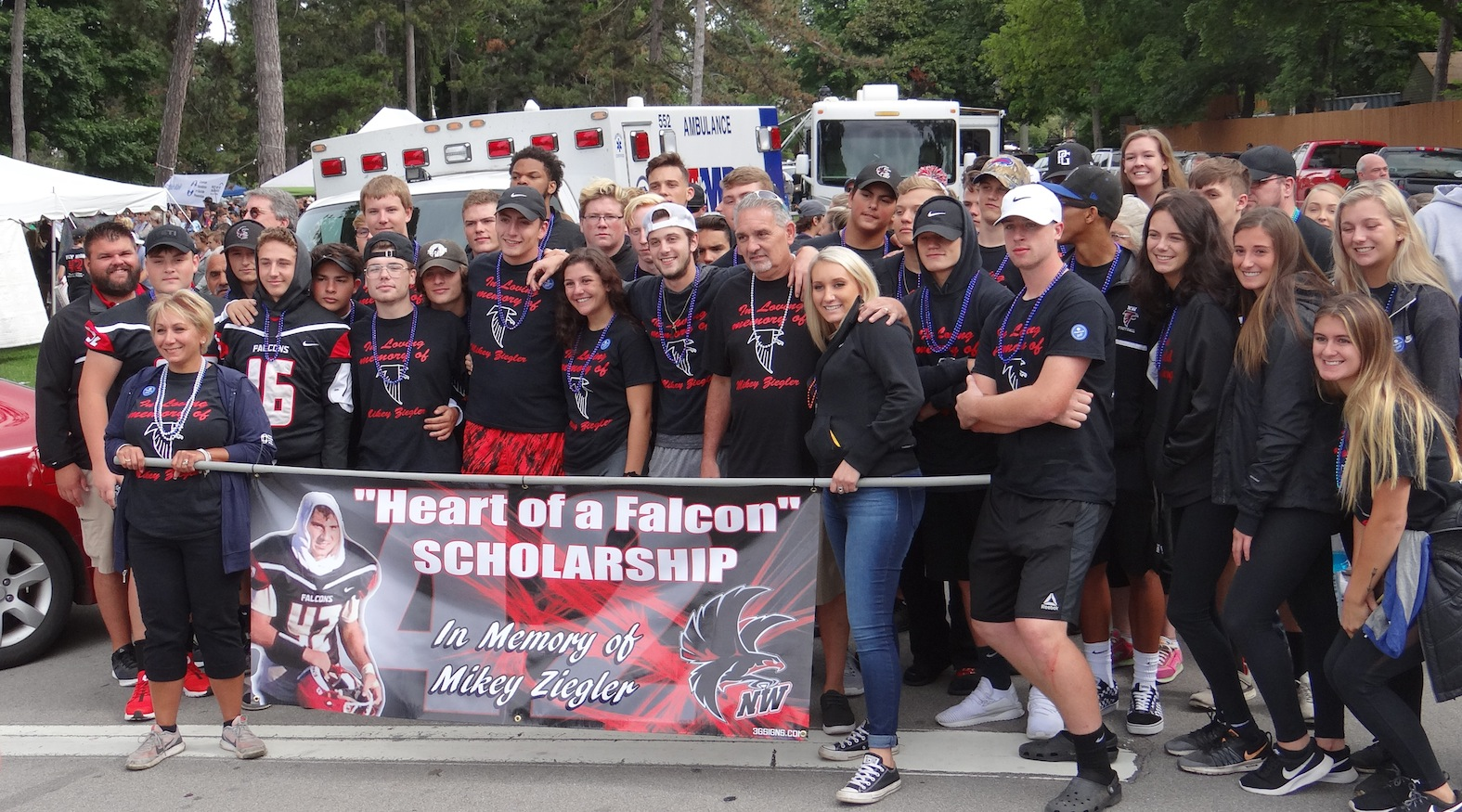 Pictured are the walkers who showed up to honor Michael Ziegler and the `Heart of a Falcon` Scholarship. (Photo by Lorna Tilley-Peltier)