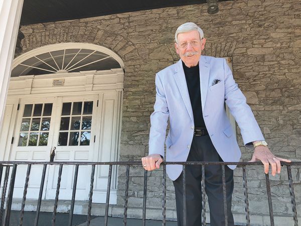 Village of Lewiston Mayor Terry Collesano stands on the Frontier House porch. He said saving the building was his top priority before he retires from office this summer.