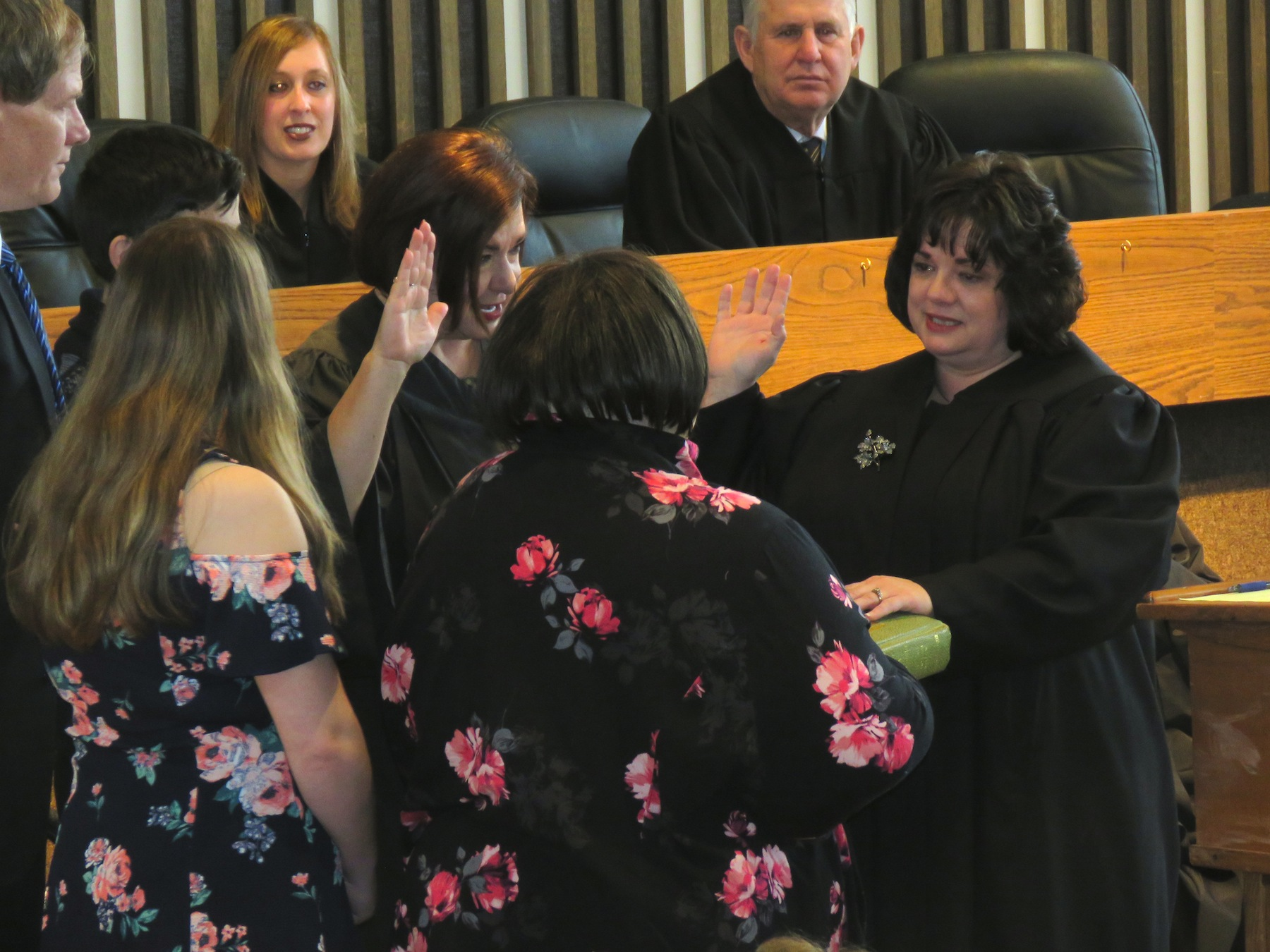 Angela Stamm-Philipps become sworn in as Wheatfield town justice by Niagara County Judge Sara Sheldon as Stamm-Philipps' mother, Audrey Stamm, holds the Bible. (Photos by David Yarger)