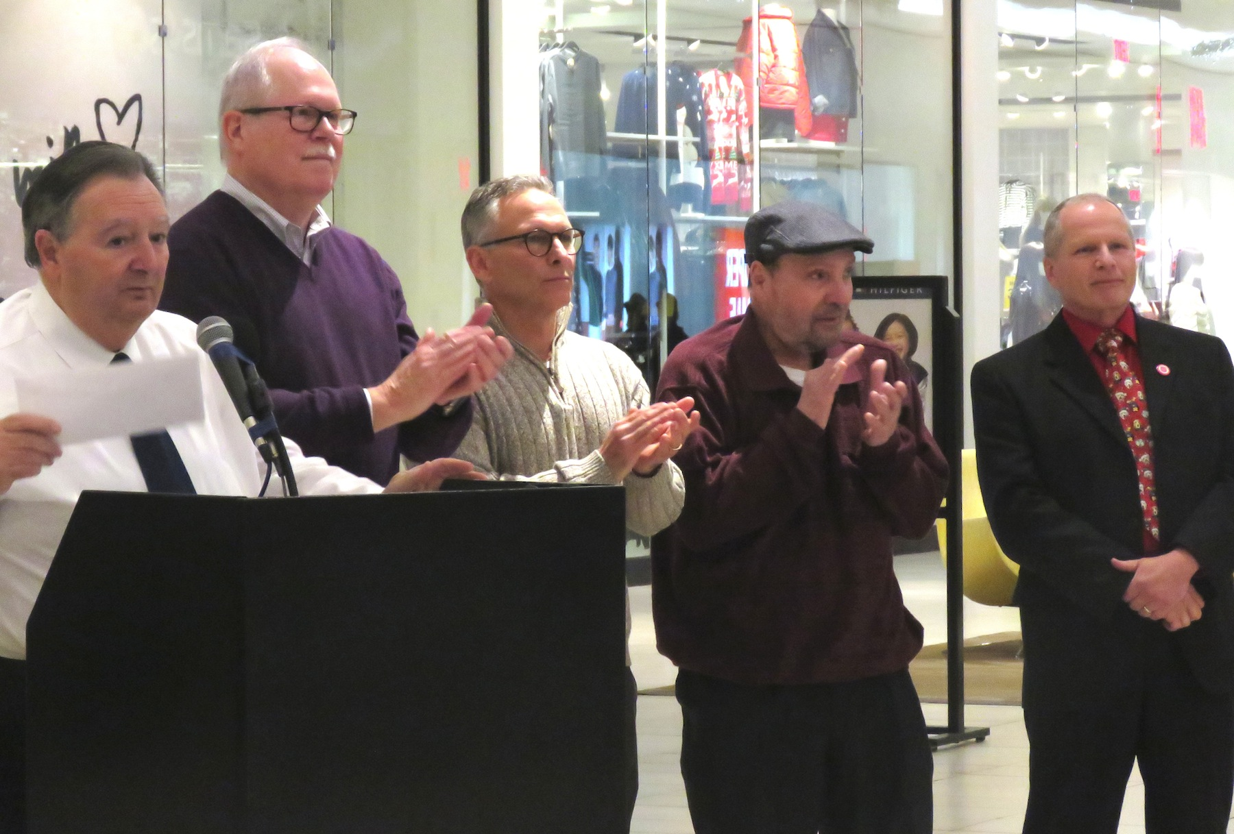From left, Town of Niagara Supervisor Lee Wallace, Town of Niagara councilmen Marc Carpenter, Sam Gatto and Rich Sirianni, and Fashion Outlets Manager John Doran hand out checks to a long list of beneficiaries Tuesday at the town and mall's `Giving Fashionably` event. (Photo by David Yarger)