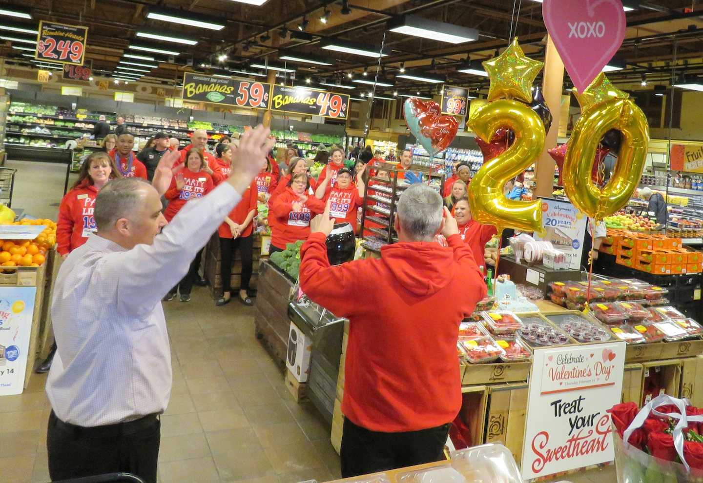 Wegmans employees celebrate the Military Road location's 20th anniversary Thursday morning. (Photos by David Yarger)