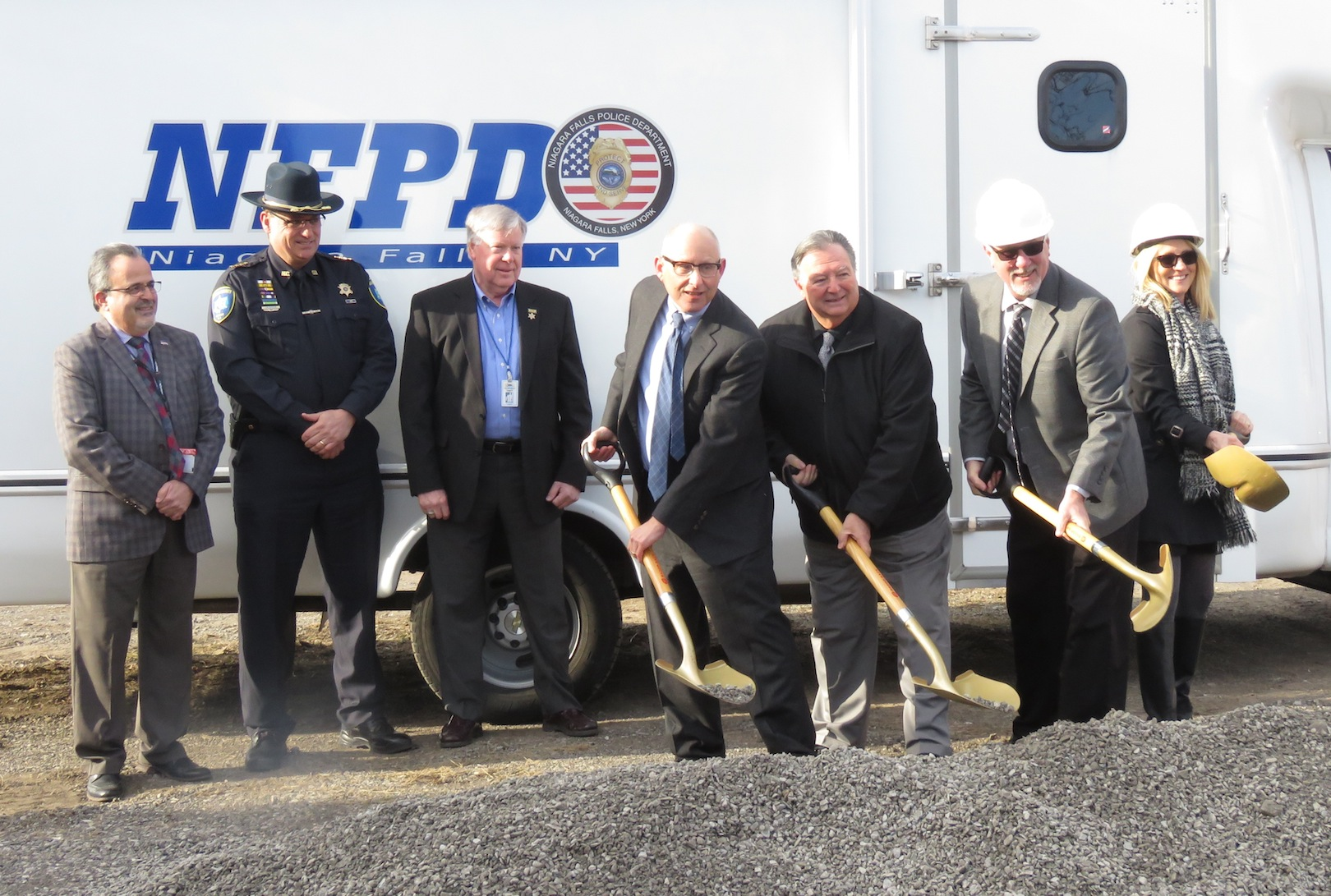From left, Niagara County Department of Economic Development Commissioner Michael Casale, Niagara County Sheriff James Voutour and Niagara County Legislator David Godfrey watch as New York State Homes and Community Renewal Assistant Commissioner Leonard Skrill, Town of Niagara Supervisor Lee Wallace, Empire Emergency Apparatus President Michael McLaughlin and Kathleen McLaughlin break ground on a new 10,000-square-foot expansion. (Photo by David Yarger)