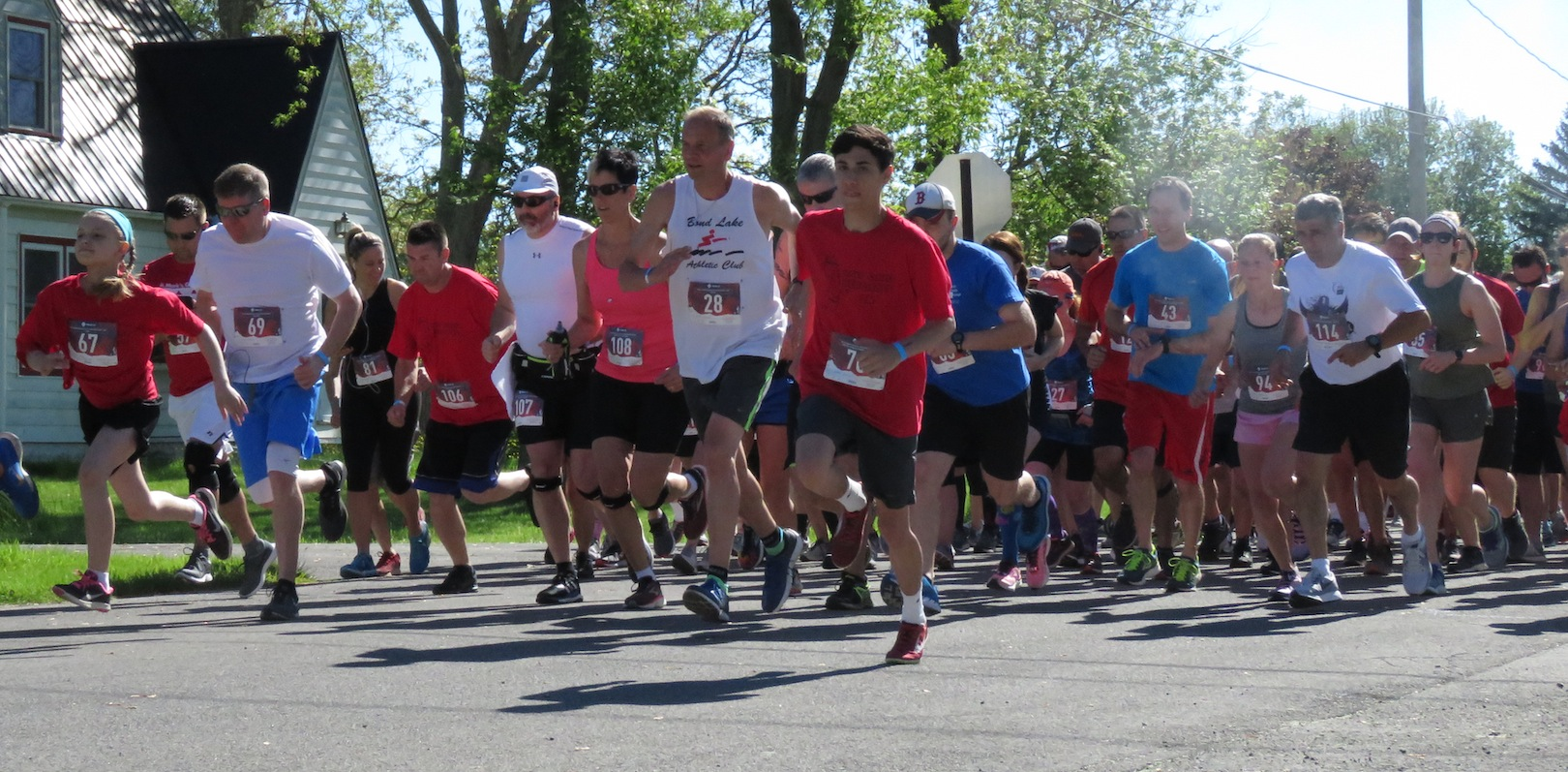 Runners take their first strides during the Bergholz 5K.