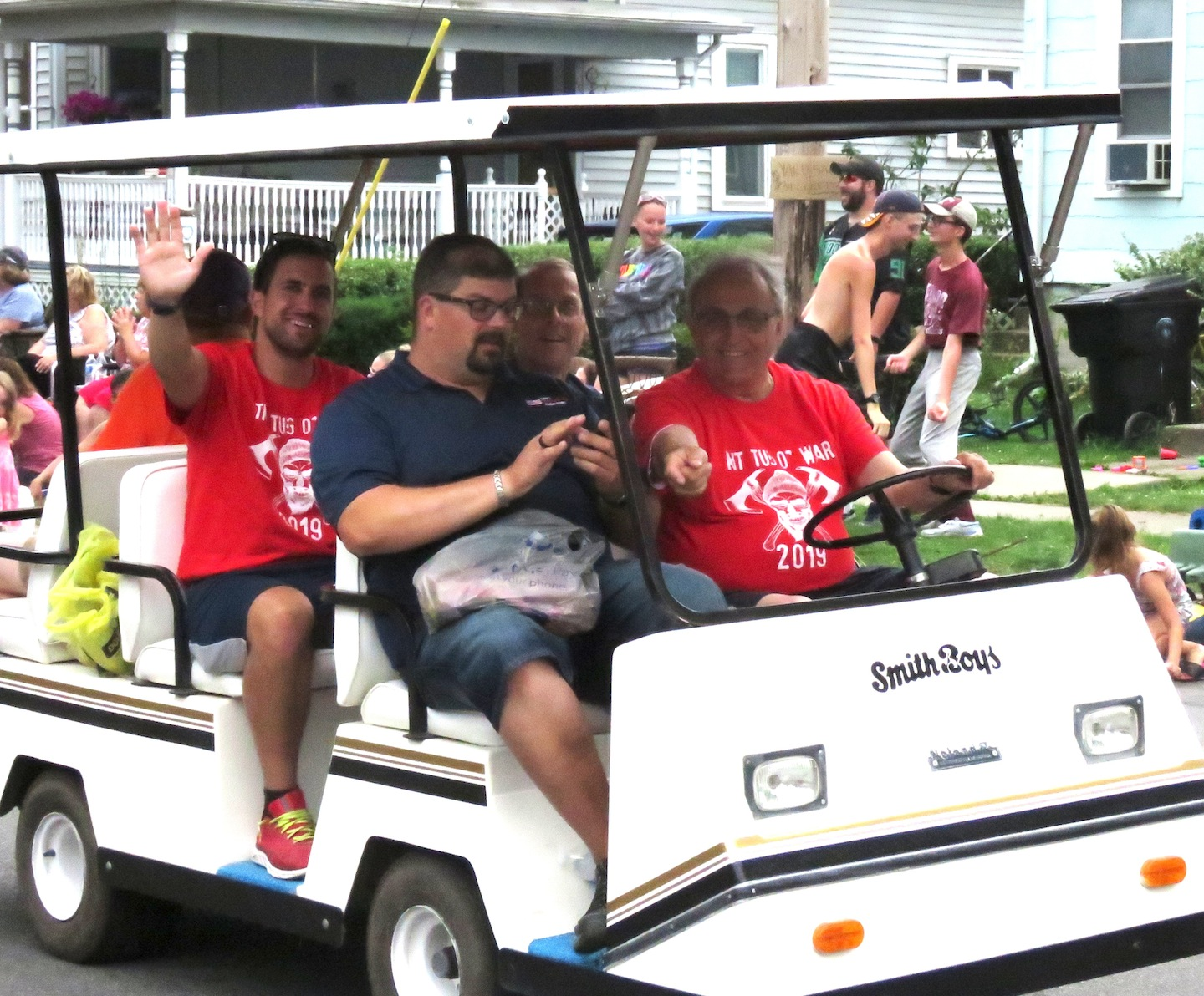 Above, North Tonawanda city officials -- Mayor Arthur Pappas (driving), Common Council President Eric Zadzilka (passenger seat), Alderman Mark Berube (back seat, at right) and Administrative Assistant Dan DiVirgilio (back seat, at left) -- stroll through the Canal Fest Parade in a golf cart. Pappas and NT officials were happy campers, as the North Tonawanda side won the tug-of-war battle, earlier in the day.