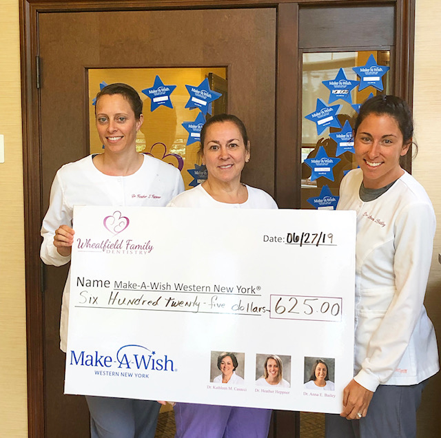 Pictured, from left, Dr. Heppner, Dr. Casacci and Dr. Bailey of Wheatfield Family Dentistry present a check for $625 to Make-A-Wish of Western New York.