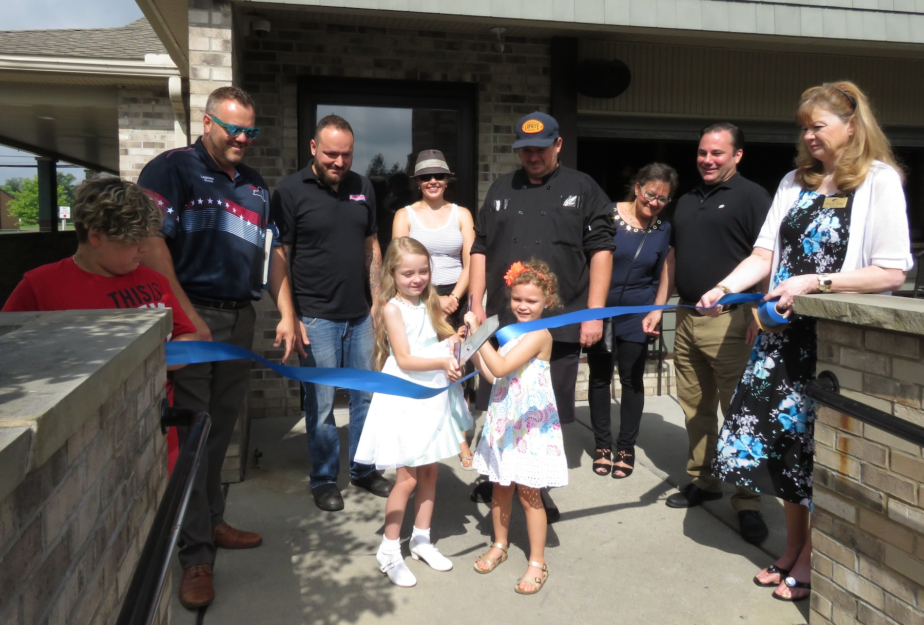 Friends, partners and family of Denny Soliday, along with Niagara County Legislator Jesse Gooch cut the ribbon to Solidays Bar & Grille's next setting at 6935 Ward Road. (Photos by David Yarger)