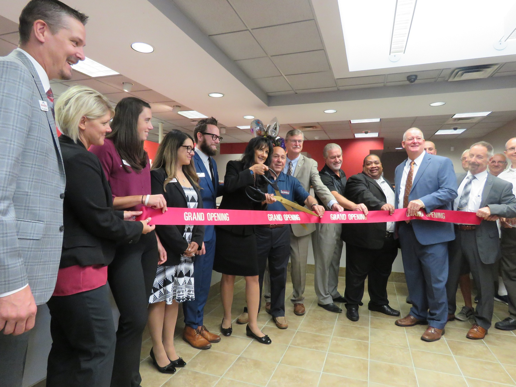 Local elected officials, BankOnBuffalo representatives and many more formally cut the ribbon to the new bank site in Wheatfield, 6947 Williams Road. (Photo by David Yarger)