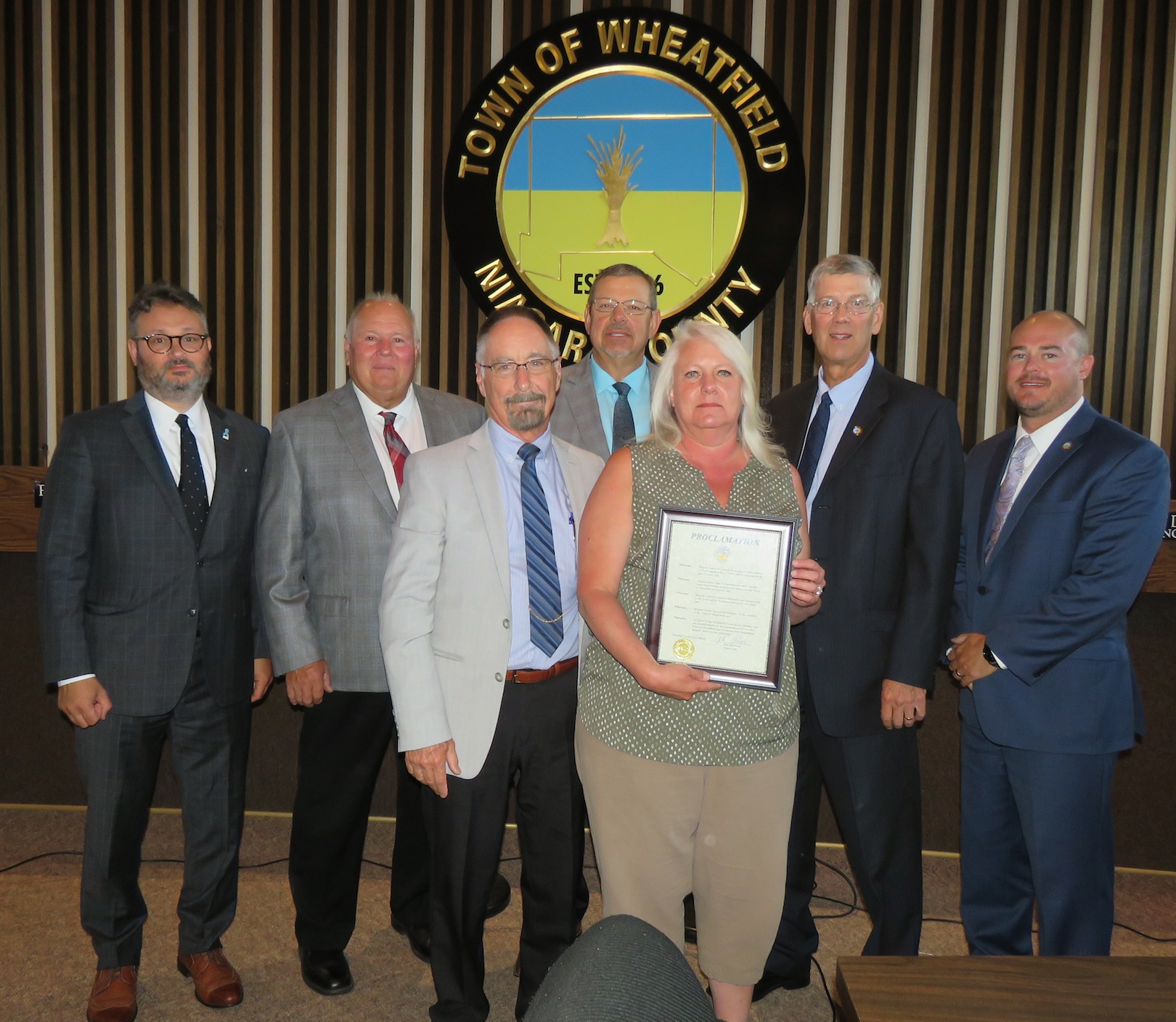 Pictured, at left, with the proclamation, from left, Town Attorney Matthew Brooks, Councilman Gil Doucet, MacSwan, Councilman Randy Retzlaff, Grawe, and councilmen Larry Helwig and Curt Doktor.