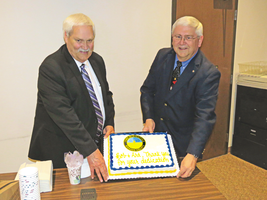 Councilman Arthur Gerbec and Supervisor Bob Cliffe pose with a cake in their honor, which says, `Thank you Bob and Art for your dedication.` (Photo by David Yarger)