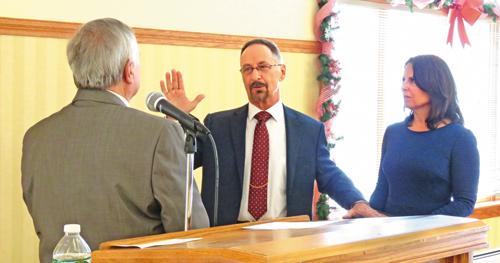 Town Supervisor Don MacSwan, alongside his wife, Mary, was sworn into office by Bill Ross.