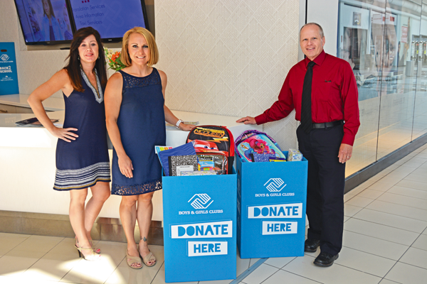 Donation bins for the Boys & Girls Club are stationed at Macerich's Fashion Outlets of Niagara Falls, USA. Pictured, from left, are, Meghan A. Ayers, marketing manager at Fashion Outlets of Niagara Falls, USA; Rebecca Vincheski, chief professional officer at the Niagara Falls Boys & Girls Club; and John Doran, senior manager at Fashion Outlets of Niagara Falls, USA. (Photo by Lauren Zaepfel)