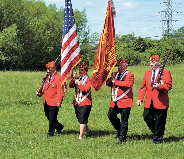 Pictured are members of the Conrad Kania Detachment of the Marine Corps League Color Guard at last year's Memorial Day ceremony. (Photo by Marc Carpenter)