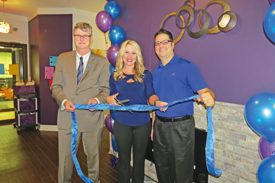 Niagara Falls Mayor Paul Dyster cuts the ribbon to officially open the Notaro Chiropractic addition in Niagara Falls. He is joined by Jodi and Dr. Thomas Notaro.