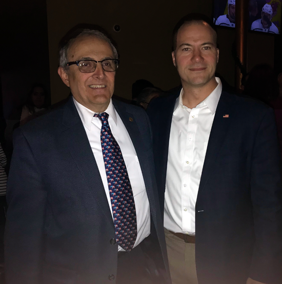 Mayor Arthur Pappas poses with New York Sen. Rob Ortt at Canal Club 62 after being announced he was re-elected by the citizens of North Tonawanda. (Photo by David Yarger)