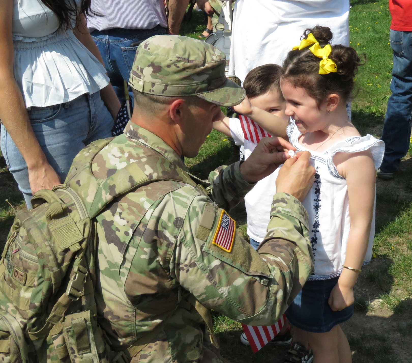 This little girl was quite happy to see her father return home. (Photo by David Yarger)