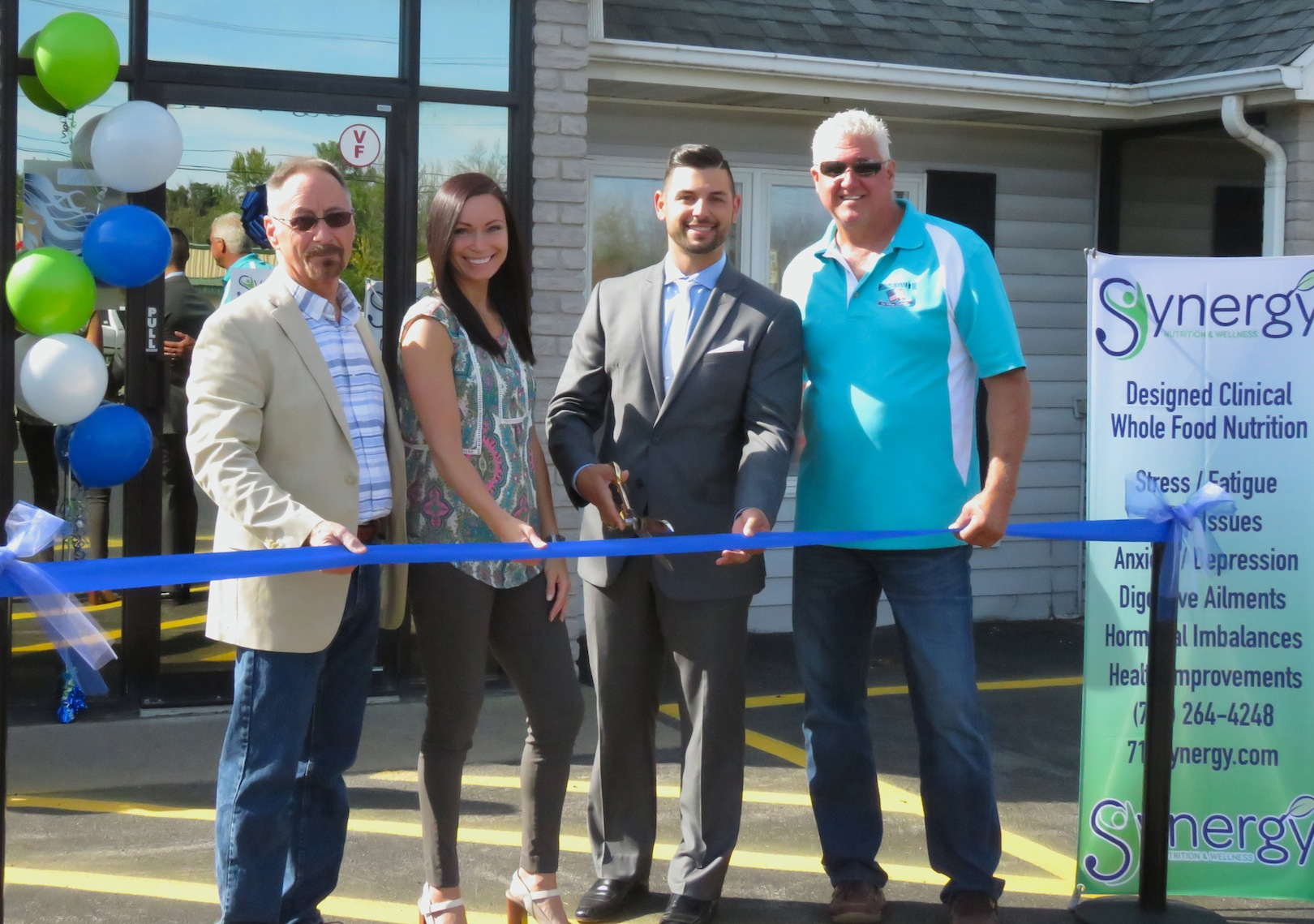 From left, Town of Wheatfield Supervisor Don MacSwan; owner of Be Moved Fitness Tara Scaringi; owner of Synergy Nutrition & Wellness Jimmy Scaringi; and partner Paul Wendt cut the ribbon to their new facility at 3376 Niagara Falls Blvd., Wheatfield. (Photos by David Yarger)