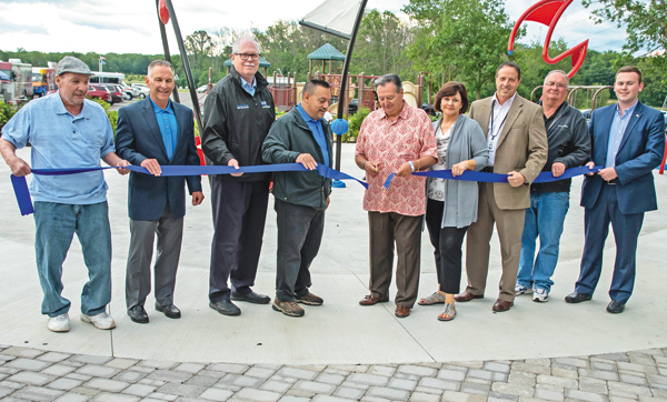 A ribbon-cutting ceremony held Monday marked the completion of Veterans Memorial Community Park's new splash pad. From left are Town of Niagara councilmen Richard Sirianni, Sam Gatto and Marc Carpenter; Deputy Supervisor Charles Texiera; Supervisor Lee Wallace; Town Clerk Sylvia Virtuoso; Niagara County Legislator Jason Zona; Highway Superintendent Robert Herman and Thomas Haag representing Congressman Chris Collins' office. (Photo by Bob Koshinski)