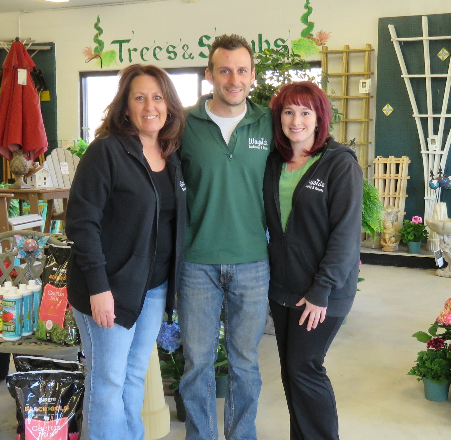 From left, Julie Rotella, Michael Rotella and Rachael Rotella all pose for a photo inside the Wayside Nursery. (All photos by David Yarger)