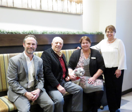 Pictured are SWBR Principal Architect Joe Gibbons, DePaul board member Gerald Scott, Hyland-Dion, and DePaul Senior Living Regional Director Tanya MacNaughton, along with Ruby, Wheatfield Commons' official mascot.