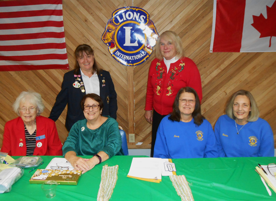 From left: Lioness Joan Shivley, and Lions Joyce Aiken, Nancy Rose and Debora Carr. Standing is Battaglia, and secretary Roberta O'Toole. Missing are Lions Francine Boore and Agnes Ryan. (Photo submitted by Justin Higner)