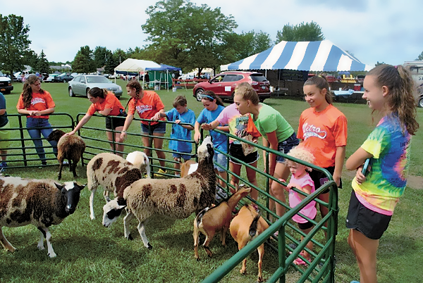 Youth enjoy meeting some of the animals at last year's picnic.