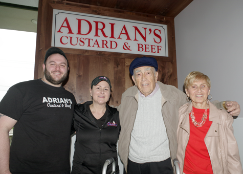Patrick Antonelli and Toni Amantia of Adrian's brought the original sign to their new location. Original owners Peter and Adrian Figliotti joined them at a ribbon-cutting for the new Adrian's Saturday.