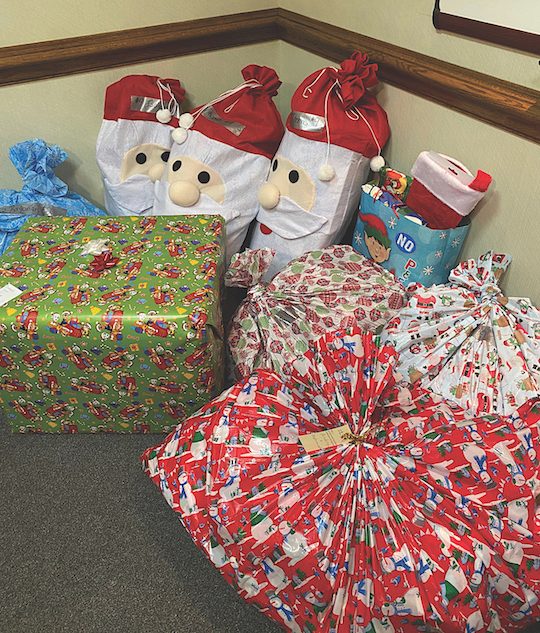 Some of the gifts collected so far for the 86 children enrolled in `Barb's Butterfly Effect` for Christmas this year. The family of the late Barbara Nowakowski (pictured below as Santa) is continuing the holiday tradition begun by their mother more than 15 years ago.