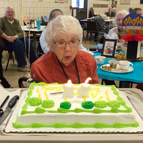 Betty Marinell blows out the candles on her 98th birthday cake at the Grand Island Golden Age Center. (Submitted photo)