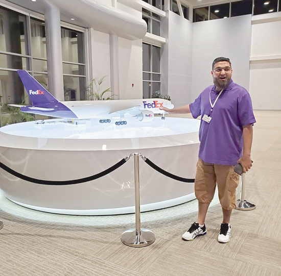Fahim Mojawalla is pictured next to a model FedEx airplane during a trip to FedEx headquarters in Memphis. He had an opportunity to tour a real plane as well as visit the airport and FedEx shipping center that handles millions of packages a night.