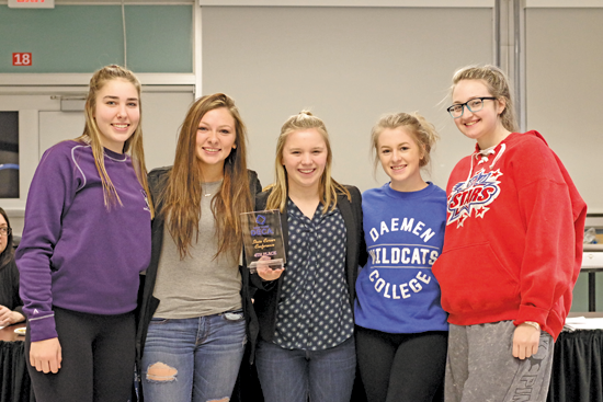 DECA students from Grand Island High School were honored at a Board of Education meeting in March after their success at the 59th DECA State Career Conference in Rochester. Eight students qualified for the national business education competition in Orlando, which takes place Sunday, Monday and Tuesday. Pictured from the BOE meeting are, from left: Bridget Neeson, Kaylee Butcher, Gabby Bergstrom, Melina Aceti and McKenna Prochaska. (Photo by Larry Austin)