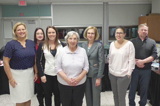 Helen Tomkinson was honored by the Grand Island Board of Education at its Feb. 11 meeting upon her retirement from the district after 53 years. Pictured, from left: Board President Ashli Dreher, Trustee Joy LaMarca, Vice President Susan Marston, Tomkinson, Sidway Elementary School Principal Denise Dunbar, Trustee Lisa Pyc and Trustee Glenn Bobeck. (Photo by Larry Austin)