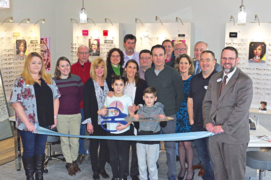 Dr. Adrienne Manzo Cassata, with the help of family, friends and leaders of Island business and government, cut the blue ribbon on the opening of Island Family Eye Care at 1780 Grand Island Blvd., suite 1. (Photo by Larry Austin)