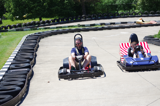 Greg Kaiser makes a pass on the go-kart course.  (Photos by Larry Austin)